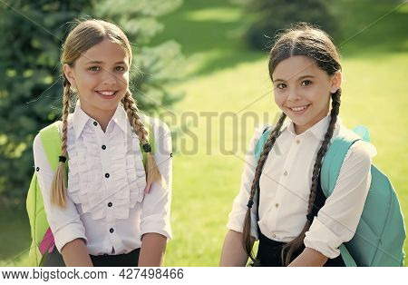 Happy Kids In Formal Uniform Enjoy Sunny Day Outdoors After School Studies, Knowledge Day