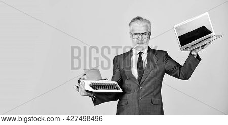Modern Instead Outdated. Connoisseur Of Vintage Values. Typewriter Against Laptop. Businessman Use M