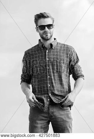 Ultraviolet Protection Concept. Man Eyewear Model Outdoors Blue Sky Background. Handsome Guy Wear Su