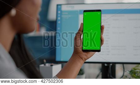 Close-up Of African Woman Holding Mock Up Green Screen Chroma Key Phone With Isolated Display In Han