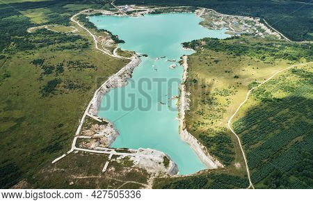 Big Mine Pit Aerial Above Top View. Green Lake In Quarry