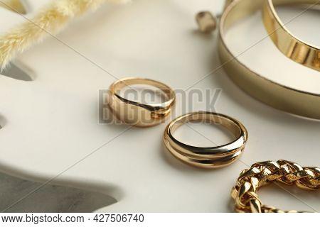 Different Elegant Bijouterie On Plate, Closeup View