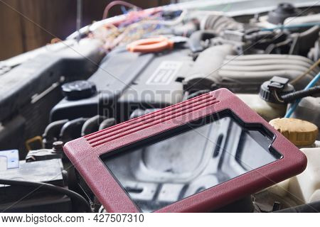 A Scanner For Car Diagnostics.auto Electrician.repair Of Electrical Equipment Of The Car.diagnostics