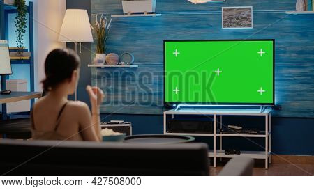 Green Screen On Modern Television Display At Home In Living Room. Caucasian Young Woman Watching Chr