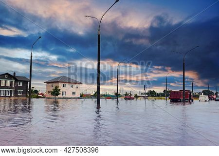 Bad Extreme Heavy Rain Storm Weather. Flooded Streets Of The Neighborhood. A Flooded Road Junction W