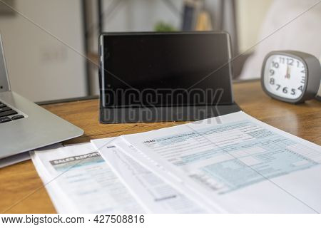 Individual Income Tax Return Form, Laptop, And Tablet For Who Have Income According To United States