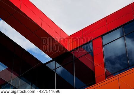 Modern Architectural Details. The Facade Is Red In Color. Modern Panel Facade With Windows