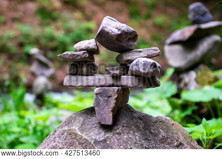 Close-up Of A Stack Of Stones In Perfect Balance In A Mountain Forest. Cairn, Art Of Balancing Rocks