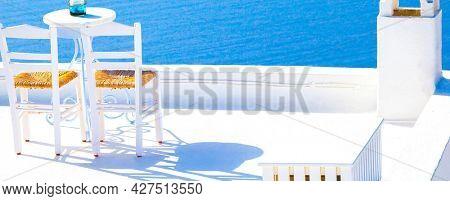 Romantic terrace restaurant, a table for the newlyweds. Oia Santorini, Greece