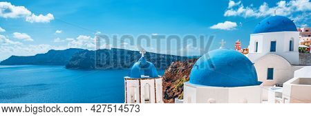 Travel summer vacation Oia, Greek island of Santorini, Greece. Europe holiday destination. Panoramic banner of view of ocean with three domes church, famous tourist attraction.