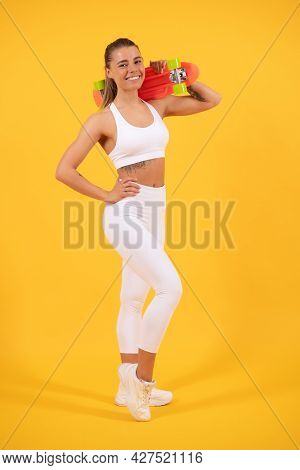 Happy Fit Girl Skater Hold Pennyboard Yellow Background, Penny Board