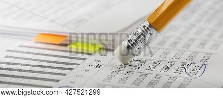 Accounting Document With Eraser Erases Blots In The Document And Checking Financial Chart. Concept O