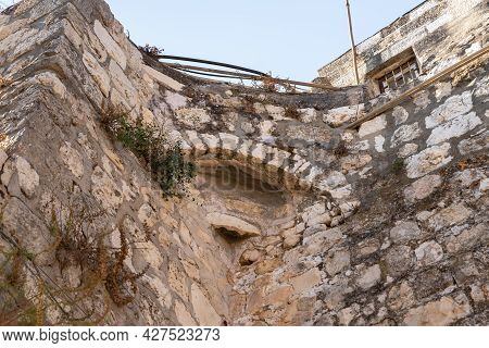The Remains Of The Stone Arched Connection On Quiet Small St James Street In The Armenian Quarter In