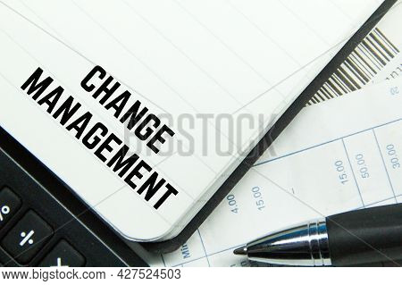 Calculator, Notebook, Pen And The Word Change Management