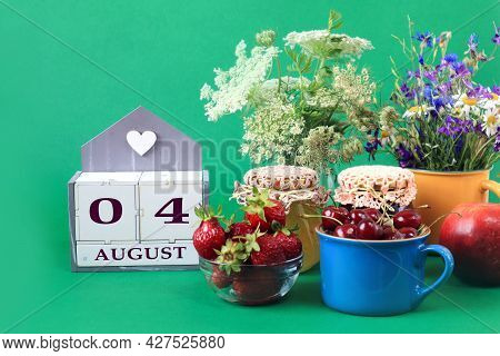 Calendar For August 4 : The Name Of The Month Of August In English, Cubes With The Numbers 0 And 4,