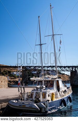 Loutra, Kytnos, Greece, 04.06.2019. Two Mast Big Blue Wooden Sailing Fishing Boat Docked At Loutra M