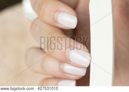Remove Nail Polish. Manicure. Correction Of Gel Polish. Cut Down The Old Varnish. Overgrown Nail Pol
