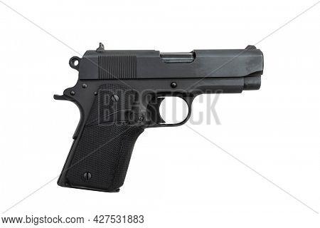 Black 45 caliber semi automatic hand gun isolated on white.