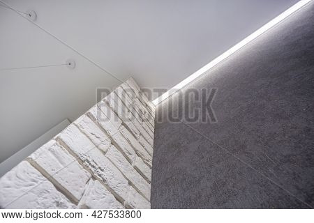 Suspended Ceiling With Halogen Spots Lamps And Drywall Construction In Empty Room In Apartment Or Ho