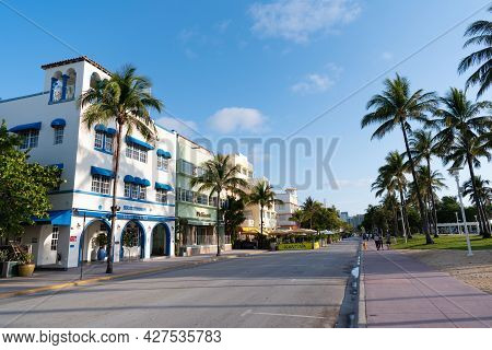 Miami, Usa - April 15, 2021: Art-deco Hotels And Palm Trees Along Ocean Drive Street In Florida