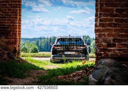 Madona, Latvia - July 20, 2021: New Skoda Enyaq Iv, A Suv Electric Car. Defocused
