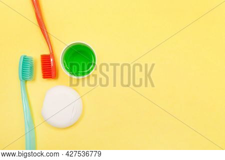Teeth Hygiene And Oral Dental Care Products. Morning Concept. Yellow Background. Oral Care Set. Copy