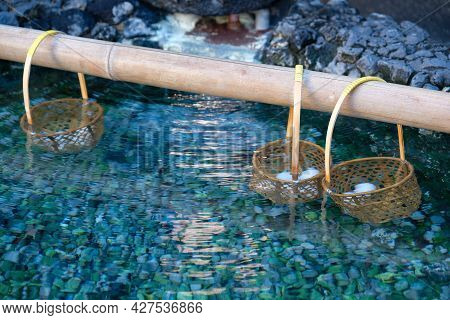 Hanging Onsen Eggs In Basket On Bamboo Rod,eggs Boiled In Hot Spring To Make Hot Spring Eggs Called