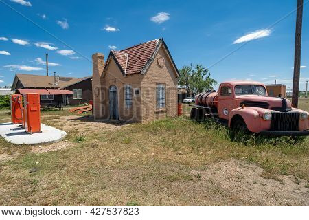 Mclean, Texas - May 6, 2021: Old Fashioned Phillips 66 Gas Stationand Old Studebaker Classic Car Tru