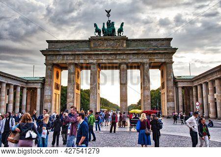 Berlin, Germany - August 26, 2014: People Visit Brandenburg Gate In Berlin. Berlin Is Germany's Larg