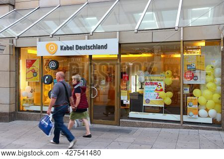 Hamburg, Germany - August 28, 2014: People Walk By Kabel Deutschland Cable Tv Store In Hamburg. The