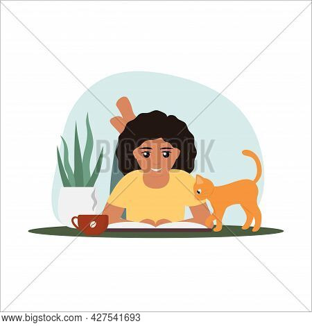Curly Haired Girl With Cup Of Coffee Is Reading A Book On The Floor. Her Curious Cat Is Looking Into