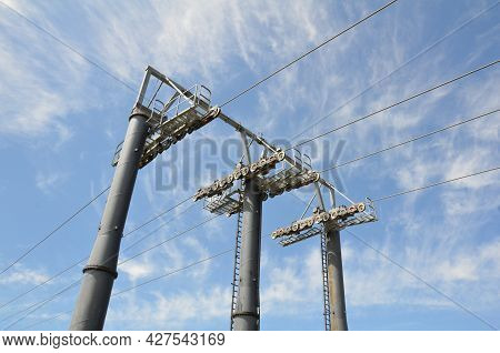 Cables And Wires And Poles On Incline Lift