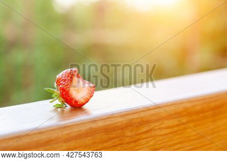 Red Strawberry Beautiful That Are Bitten On The Wooden Beam