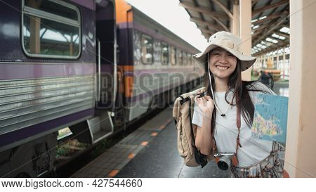 Portrait, Asian Woman Traveler Tourist Smiling And Looking To Camera With Backpack, Tourist Map, Cam