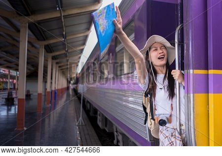 Travel Lifestyle. Portrait Young Woman Travelers Raising Her Hand Acting Glad To Travel On The Door