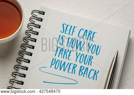 self care is how you take your power back - inspirational handwriting in a spiral notebook with a cup of tea, health, empowerment and personal development concept