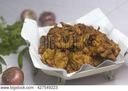 Onion Fritters. Deep Fried Onions Slices Coated With Ground Flour And Masala. A Popular Snack In Ind