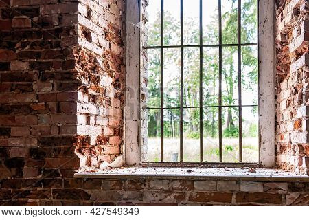 Inside Interior Of An Old Abandoned Church In Latvia, Galgauska, Window Arches In An Old Brick Wall
