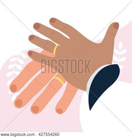 Hands Of A Husband And Wife Who Trained And Put On Wedding Rings