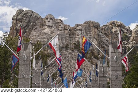 Black Hills, Keystone, Sd, Usa - May 31, 2008: Mount Rushmore. Colorful State Flags In Front Of The