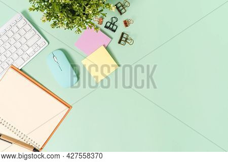 Creative Flat Lay Photo Of Workspace Desk. Top View Office Desk With Keyboard, Mouse And Open Mockup