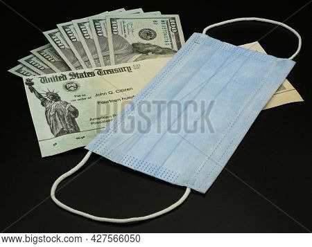 Lake Elsinore, Ca - July 20, 2021: United States Economic Stimulus Check For Covid-19 With Mask And