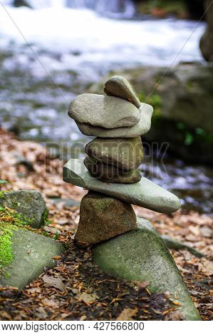 Close-up Of A Stack Of Stones In Perfect Balance In A Mountain Forest. Rock Pyramid, Rock Balancing