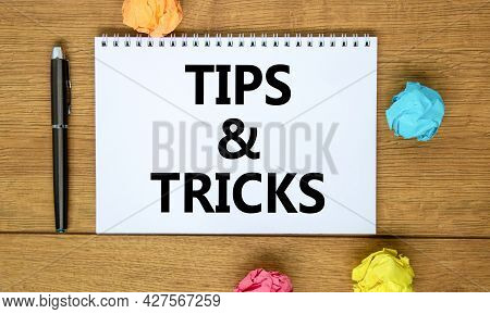 Tips And Tricks Symbol. Words 'tips And Tricks' On White Note On Beautiful Wooden Table, Colored Pap