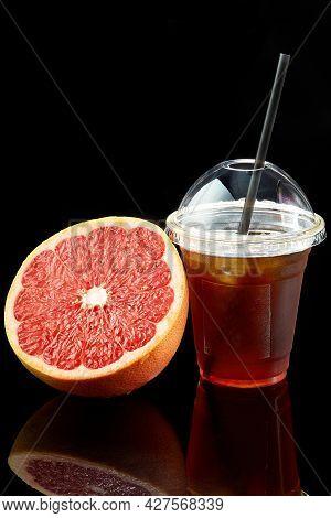 Grapefruit Fresh In A Plastic Transparent Glass