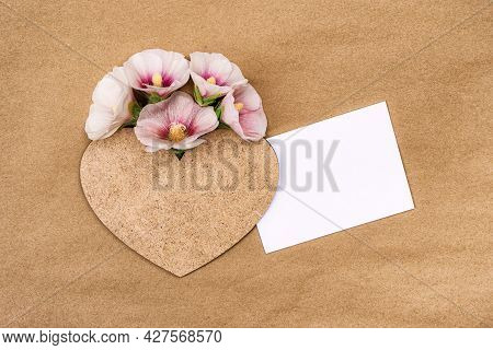 A Bouquet Of Pink Flowers Mallow With A Heart. Greeting Card With Place For Design.