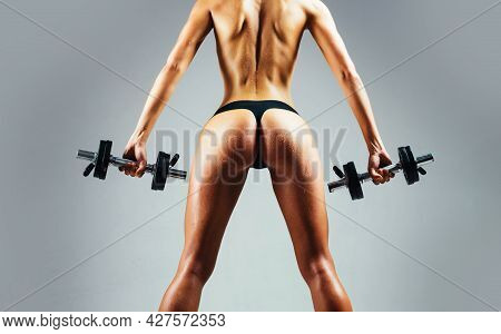 Super Body. Sporty Female Athlete Doing Fitness Workout. Beautiful Slim Womans Body. Muscular Female