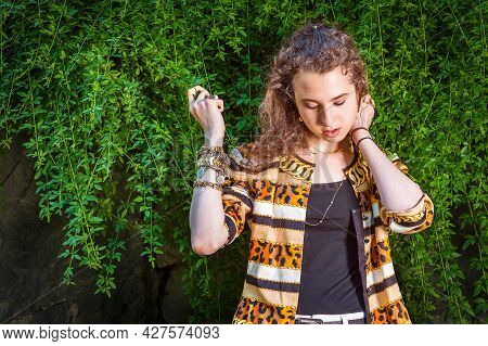 Thinking On Green. Dressing In Black Under Wear, A Patterned Fashion Jacket, Hands Holding Leaves, A