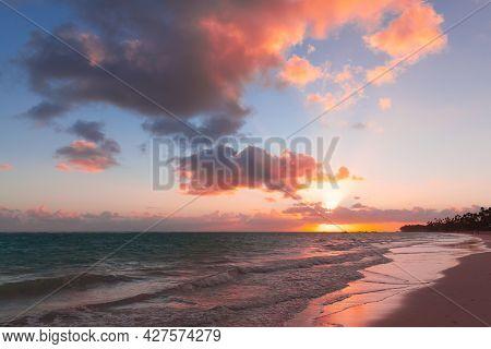 Seascape With Colorful Clouds On A Sunrise Over Atlantic Ocean Coast, Bavaro Beach, Punta Cana. Domi