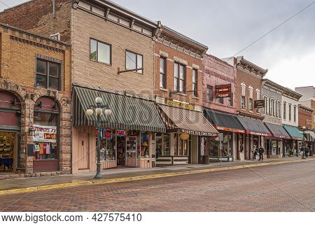 Deadwood Sd, Usa - May 31, 2008: Downtown Main Street. Harley Davidson And Other Stores In Brick Bui